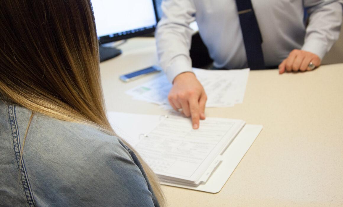 agent presenting paperwork